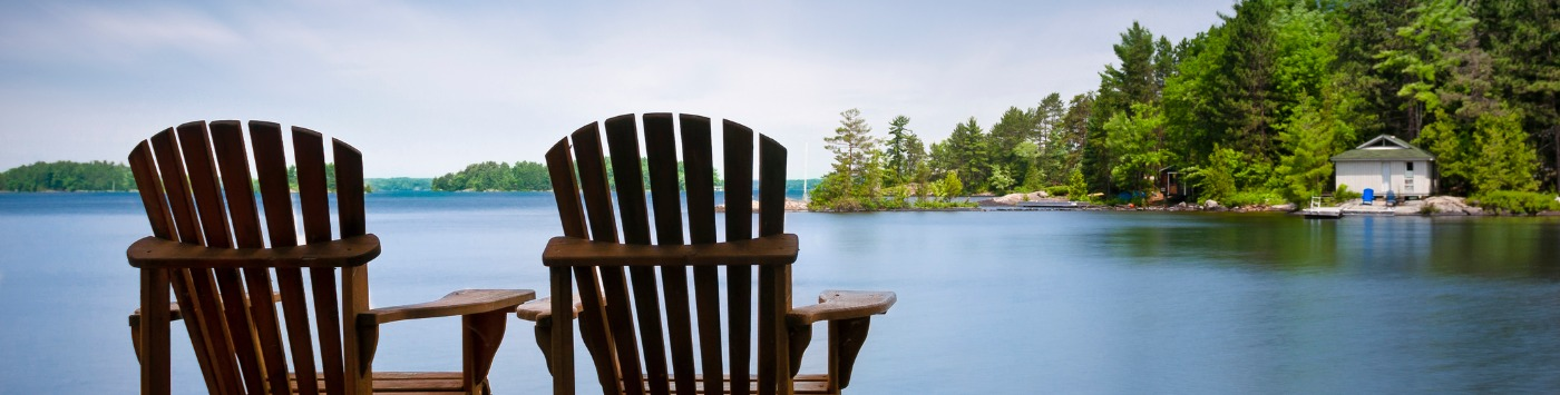 WEBIMAGES: wood-muskoka-chairs-on-a-lake-deck-picture-id482345735.jpg